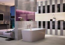 Ein unaufgeregtes Grau lässt knallige Farben im Bad noch besser zur Geltung kommen. (Foto: epr/Villeroy & Boch)