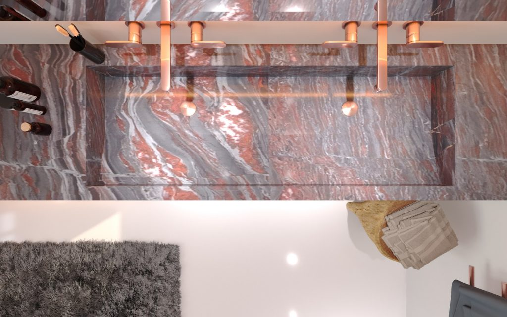 """Badarchitektur zwischen Purismus und Natürlichkeit Das Projekt, das nach den Ideen des renommierten Designers Torsten Müller vom 3D-ArtistFranz-Lorenz Wagner aus Stuttgart verwirklicht wurde, baut auf einem großzügigen Raumkonzept auf, in dem Naturstein und Edelmetalle gemeinsam mit der Trendfarbe Weiß eine aufregende Beziehung eingehen. Der erste Blick erfasst den demonstrativen Einsatz des von zahlreichen grauen, braunen und weißen Adern durchzogenen Granit """"Red Iron"""" aus der Kollektion des Herstellers Huber Naturstein. Dieser umarmt die Badewanne, bildet eine gemütliche Sitzbank ab, gestaltet das Doppelwaschbecken und kleidet auch die bodenebene Dusche aus. Ergänzt wird die feine Maserung in Rottönen von den Armaturen und Badezimmeraccessoires in einem warmen Roségold. Direkt vor dem Doppelfenster findet sich die nach Maß angefertigte rechteckige Badewanne, die perfekt in die kleine Nische passt und neben purer Entspannung auch herrliche Ausblicke bietet. Das schneeweiße Bidet und die daneben platzierte Toilette von Famina werden in die Natursteinkulisse eingegliedert. Die Dusche in der Ecke wird durch den roten Granit, der den Boden und die Wände bedeckt markiert. Das Dornbracht-System besitzt eine LED-Funktion, die den groben Stein in neue Lichtspektakel integriert. Eine kleine Lounge-Zone mit einer bequemen Sitzbank lässt Wohnlichkeit in das exklusive Badezimmer hinein und unterstützt mit den weichen Textilen den Eindruck eines Wohnraumes, in dem es nicht nur auf die Pflege des Körpers sondern auch auf jene der Seele ankommt."""